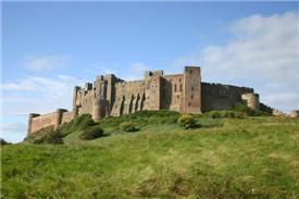 castle perched high on a hill - bamburgh castle